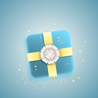 Caja de regalo decorativa con lazo de plata y oro.