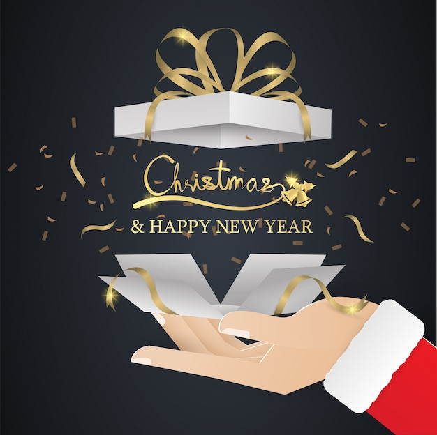 Caja de regalo dorada bomba en mano santa