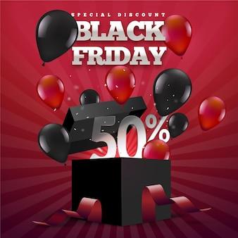 Caja de regalo y globos de viernes negro realista