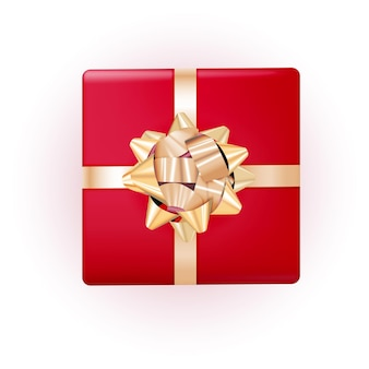 Caja de regalo con lazo dorado y cinta.