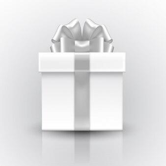 Caja de regalo con lazo plateado.