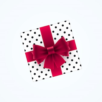 Caja de regalo con lazo rojo.