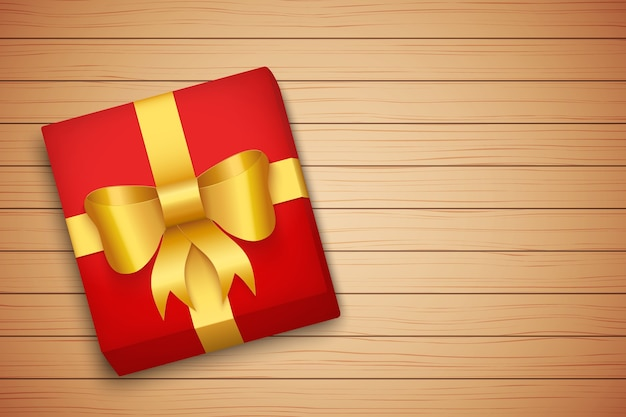 Caja de regalo en mesa de madera marrón.