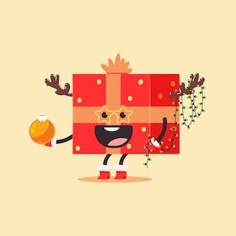 Caja de regalo de navidad divertida con arco, asta de reno y carácter de guirnalda ligera en el fondo.