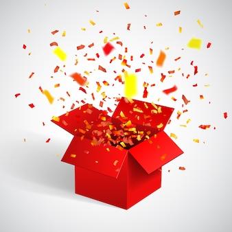 Caja de regalo roja abierta y confeti.