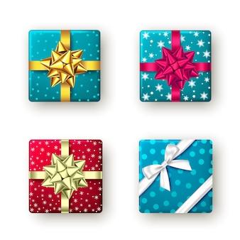 Caja de regalo roja, dorada, azul con cinta y lazo, vista superior. diseño de paquete de navidad, fiesta de año nuevo, feliz cumpleaños o día del padre. presente aislado sobre fondo blanco. vector.