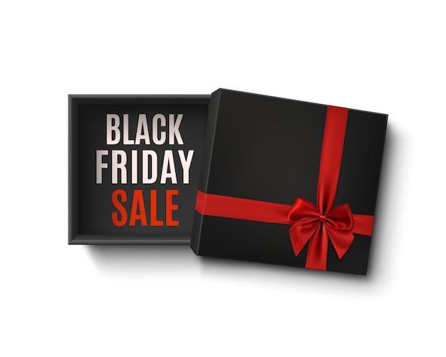 Caja de regalo vacía negra abierta con cinta roja y arco aislado sobre fondo blanco.