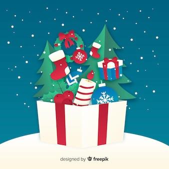 Caja con regalos dentro de papel estilo