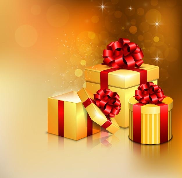 Cajas de regalo doradas abiertas con lazo rojo y cinta