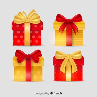 Cajas de regalo doradas y rojas con cinta