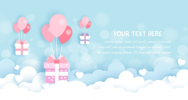Cajas de regalo con globos en el cielo en papel cortado