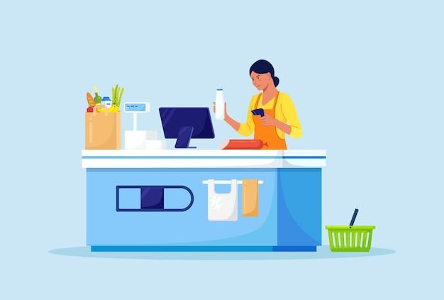 Cajero de mujer minorista con escáner de código de barras de pie en la caja registradora en la tienda. equipo de mostrador de tienda de supermercado y empleado en uniforme