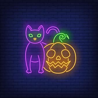 Calabaza aterradora y letrero de neón de gato