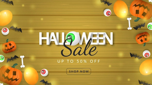 Calabaza de banner de venta de halloween sobre fondo de madera