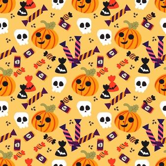 Calabaza de halloween y patrones sin fisuras de caramelo.