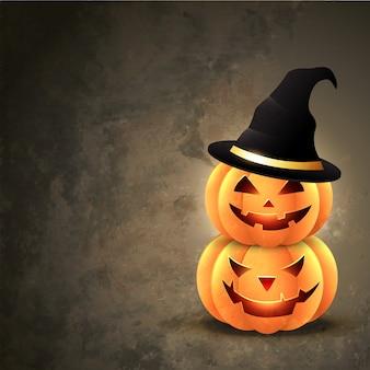 Calabazas de halloween con sombrero sobre fondo grunge