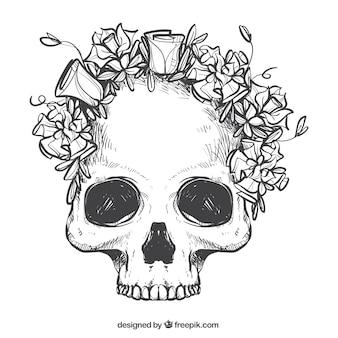 Calavera con corona de flores dibujadas a mano