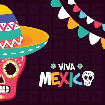 Calavera mexicana con sombrero y guirnaldas