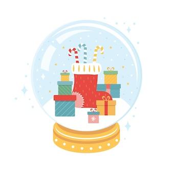 Calcetín de navidad festivo, bastón de caramelo, regalos dentro de una bola de nieve de navidad.