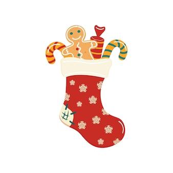 Calcetín tradicional navideño con dulces hombre de jengibre de jengibre