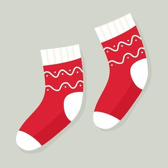 Calcetines de vacaciones de invierno con estampados. calcetines navideños. en estilo de dibujos animados plana.