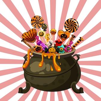 Caldero de halloween lleno de caramelos y dulces.