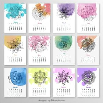 Calendario anual con mandalas y salpicaduras de acuarela