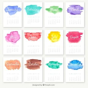 Calendario anual con manchas de acuarela