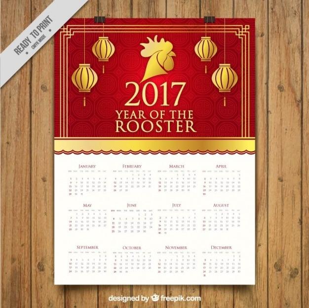Calendario dorado y rojo para el año del gallo