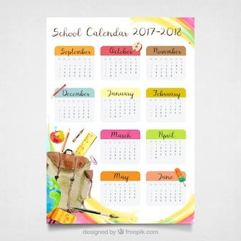 Calendario escolar moderno con materiales en acuarela