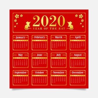 Calendario de fondo rojo con símbolos dorados para año nuevo chino
