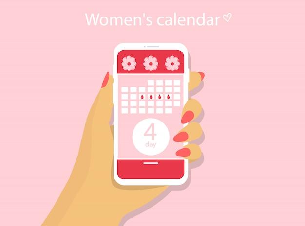 Calendario menstrual solicitud de un teléfono con calendario femenino. una mano sostiene un teléfono.