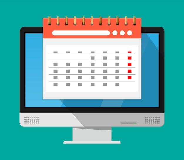 Calendario de pared espiral de papel en computadora