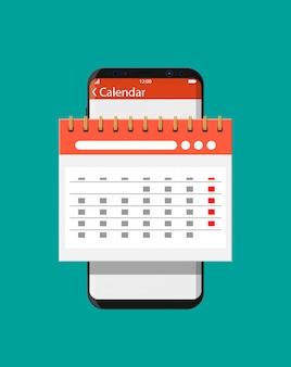 Calendario de pared espiral de papel en smartphone