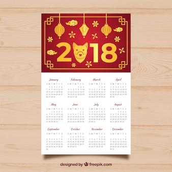 Calendario rojo y dorado de año nuevo chino
