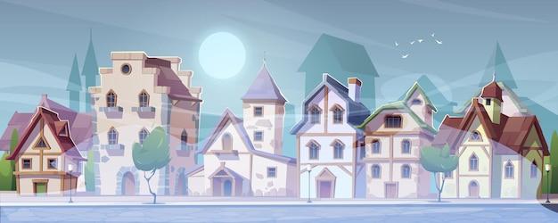Calle alemana medieval con casas de entramado de madera con niebla blanca