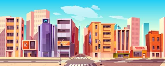 Calle de la ciudad con casas, tiendas y carreteras.