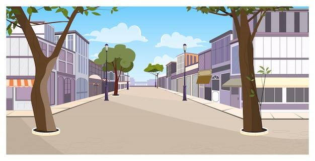 Calle de la ciudad con edificios, árboles y pavimento vacío.