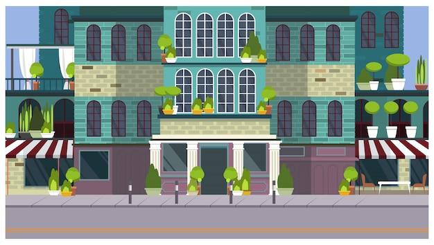 Calle de la ciudad vacía con hermoso edificio y plantas