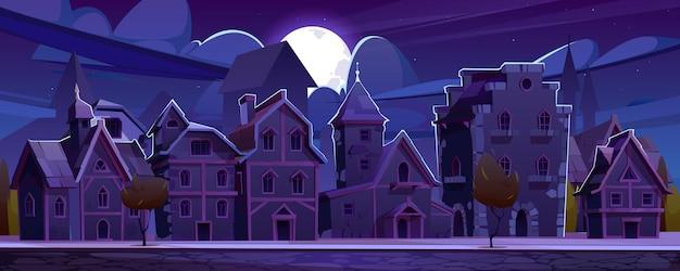 Calle europea medieval con casas de entramado de madera en la noche