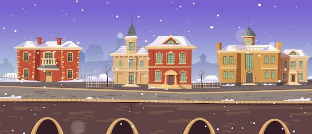 Calle de invierno de la ciudad vintage con edificios victorianos coloniales europeos y paseo del lago