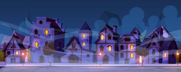 Calle de la noche alemana medieval con casas de entramado de madera en la niebla