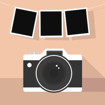 Cámara polaroid y fotografías