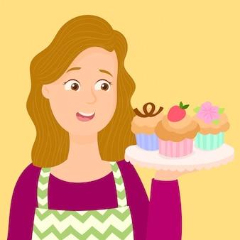 Camarera mostrando un plato de cupcakes.
