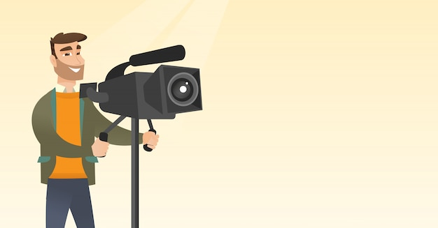 Camarógrafo con una cámara de cine sobre trípode.