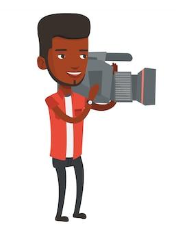 Camarógrafo con cámara de cine en trípode.