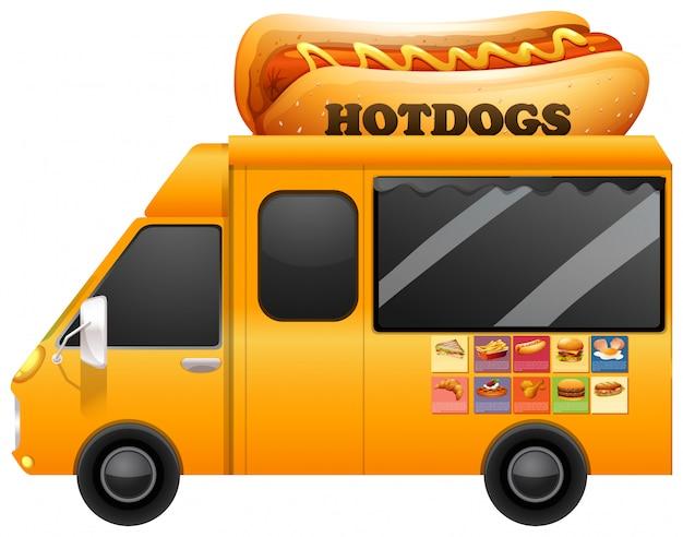 Camion amarillo de comida con perritos calientes gigantes