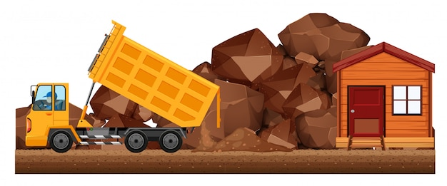 Camión de dumping vertiendo suelo en el sitio de construcción