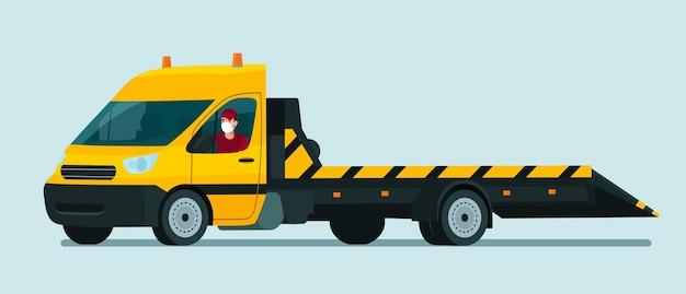 Camión de remolque con un conductor en máscara médica aislado.