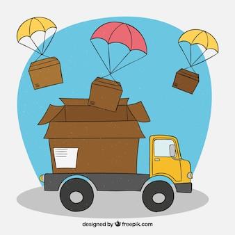Camión de reparto y cajas con paracaídas